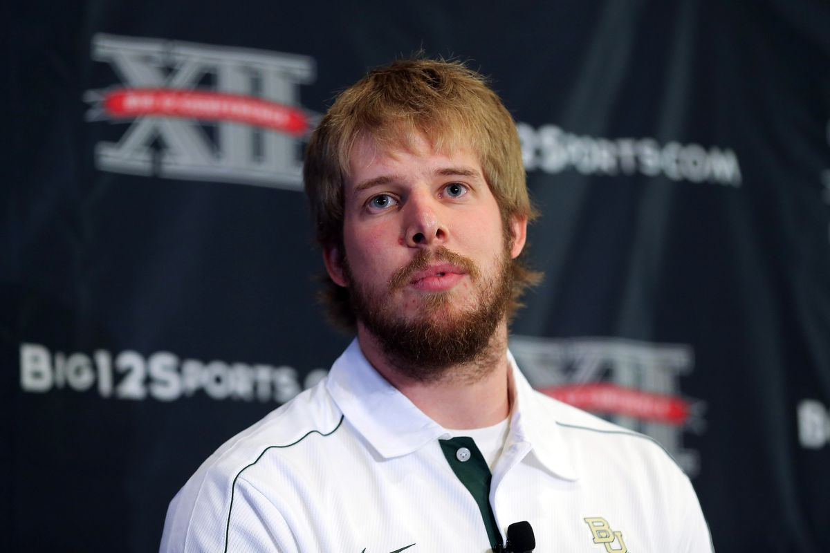 All I do is throw touchdowns and rock sweet facial hair, and it appears the scrimmage is over ... Mandatory Credit: Kevin Jairaj-US PRESSWIRE