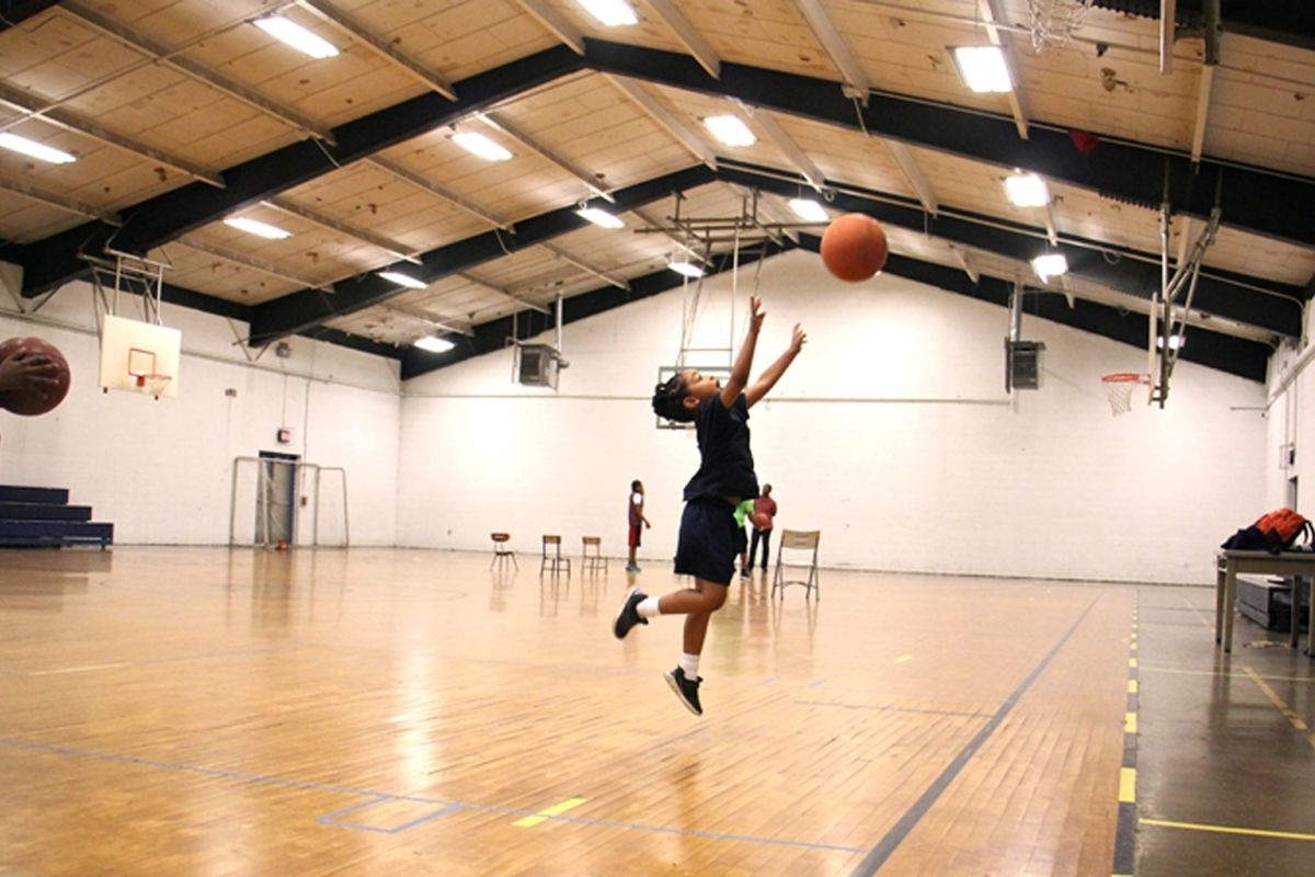 A kid shown playing in a gym in Philadelphia.