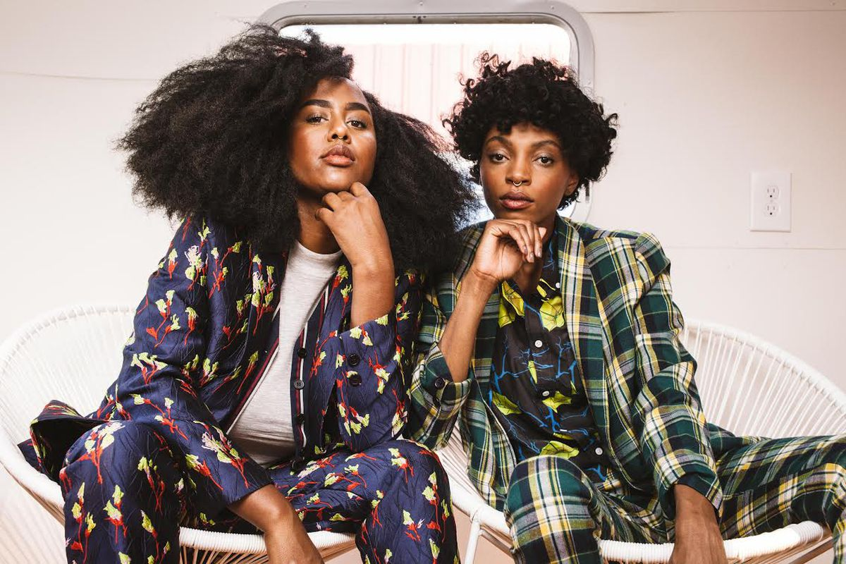 Two women in Wildfang printed suits.