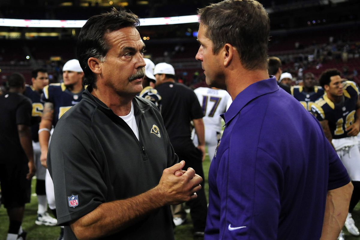 August 30, 2012; St. Louis, MO, USA; St. Louis Rams head coach Jeff Fisher talks with Baltimore Ravens head coach John Harbaugh after a game at the Edward Jones Dome. The Rams won 31-17. Mandatory Credit: Jeff Curry-US PRESSWIRE
