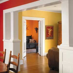 Two color interior walls with living room painted yellow and kitchen walls painted red.