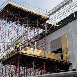 Work at the top of a scaffold on the west side of the park