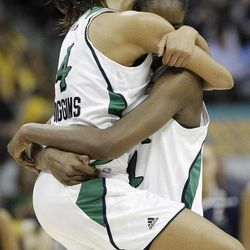 Notre Dame guard Skylar Diggins (4) and Notre Dame forward Devereaux Peters (14) embrace after overtime in the NCAA women's Final Four semifinal college basketball game against Connecticut, in Denver, Sunday, April 1, 2012. Notre Dame won 83-75.