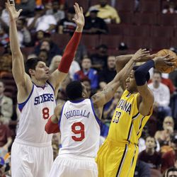 Indiana Pacers' Danny Granger, right, tries to pass under pressure form Philadelphia 76ers' Nikola Vucevic, left, of Montenegro, and Andre Iguodala in the first half of an NBA basketball game, Tuesday, April 17, 2012, in Philadelphia.