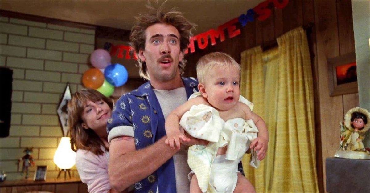 Nic Cage holds a baby