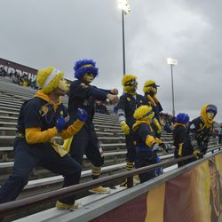 Members of the Toledo Blue Crew dance along with cheerleaders during play late in the fourth quarter.