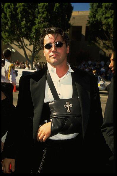 Matt LeBlanc wearing a black leather sling with a cross on it