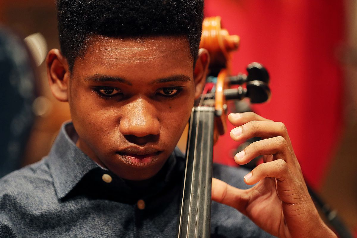 Getro Joseph, a young cellist from Haiti, concentrates on his music as he plays with John Eckstein of the Utah Symphony as the two have a short practice session at Abravanel Hall in Salt Lake City on Saturday, Dec. 7, 2019. Getro also met with Congressman Ben McAdams, who assisted Getro with the visa process for his trip to Utah.