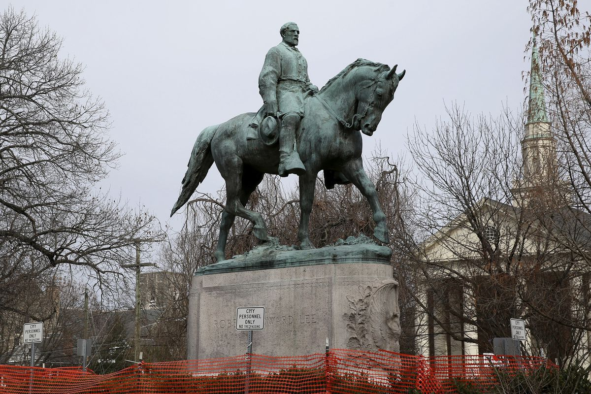 The statue of Robert E. Lee is seen uncovered in Emancipation Park in Charlottesville, Va., on Wednesday, Feb. 28, 2018.