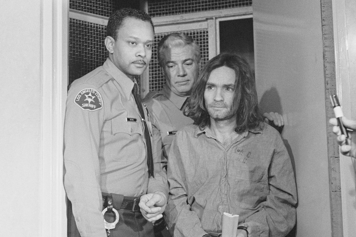 (Original Caption) Los Angeles: Charles Manson, hippie cult leader and accused mastermind in the killing of Sharon Tate and several other persons last year, arrives in court to enter a plea to seven counts of murder and one count of conspiracy. Manson, who previously had a heavy beard, was clean shaven for his appearance in which he intends to act as his own attorney.