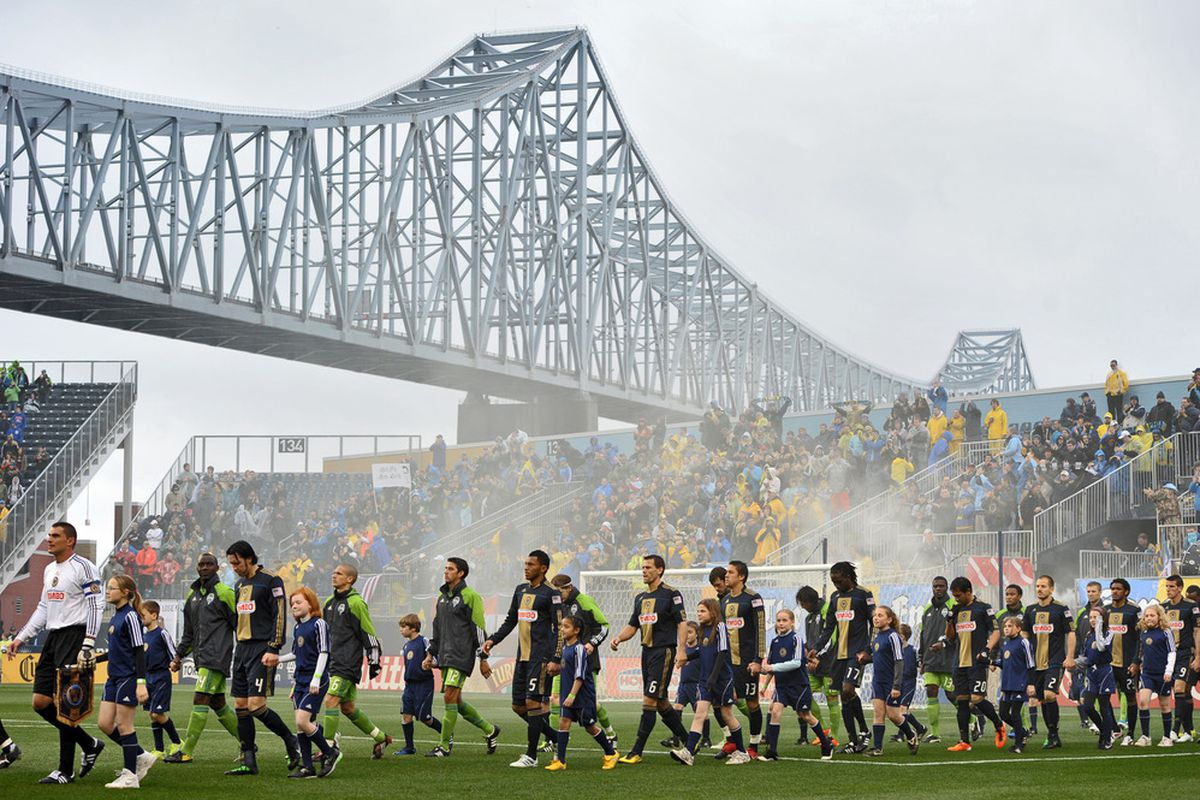 CHESTER, PA- APRIL 16:  The Philadelphia Union and Seattle Sounders FC walk on to the field before the start of the game at PPL Park on April 16, 2011 in Chester, Pennsylvania. The game ended 1-1 tie. (Photo by Drew Hallowell/Getty Images)
