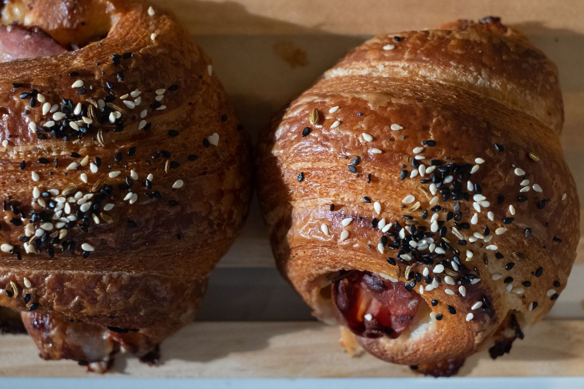 Poppyseed studded croissants stuffed with ham and cheese