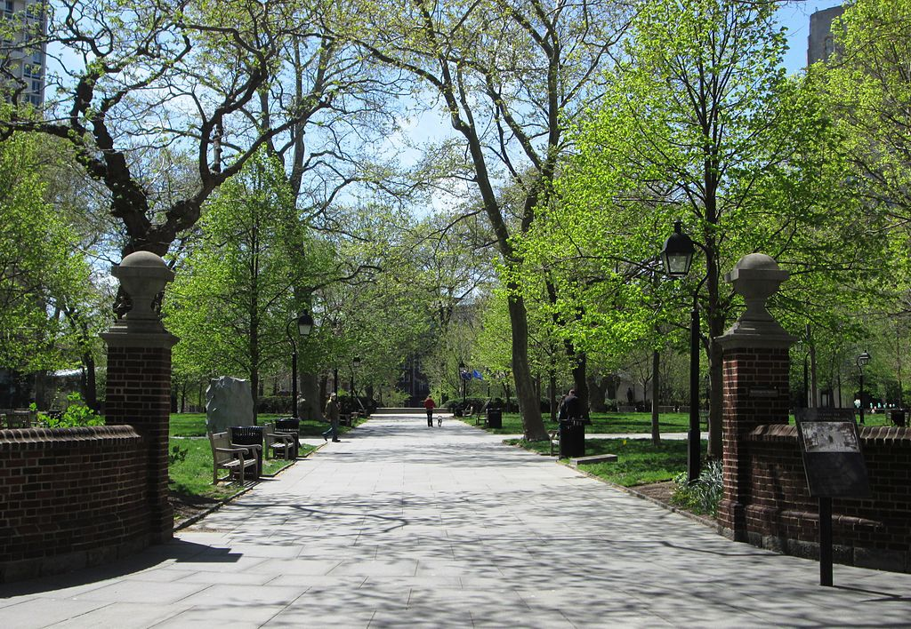A path in Washington Square, Philadelphia. The path is lined with trees.