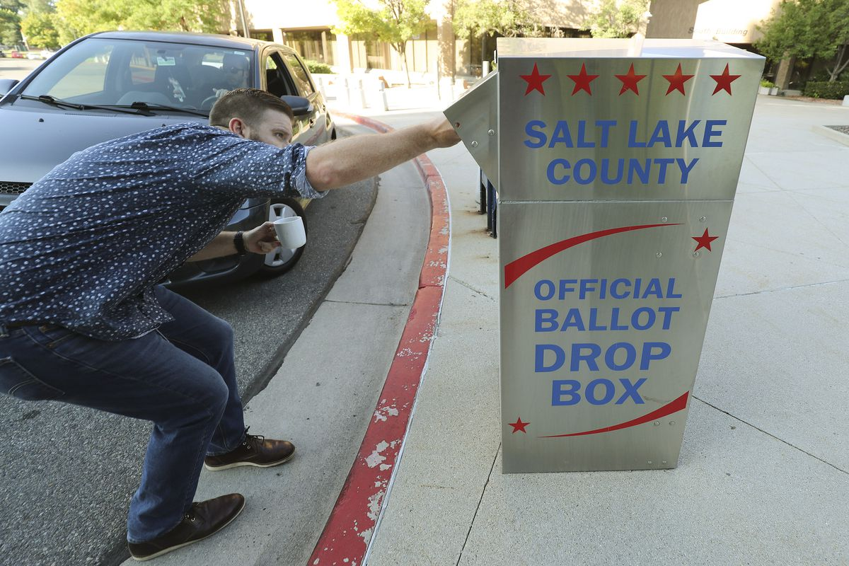 Patrick Kilbourn drops off his mail-in ballot at the Salt Lake County Government Center in Salt Lake City in this Aug. 13, 2019 file photo.