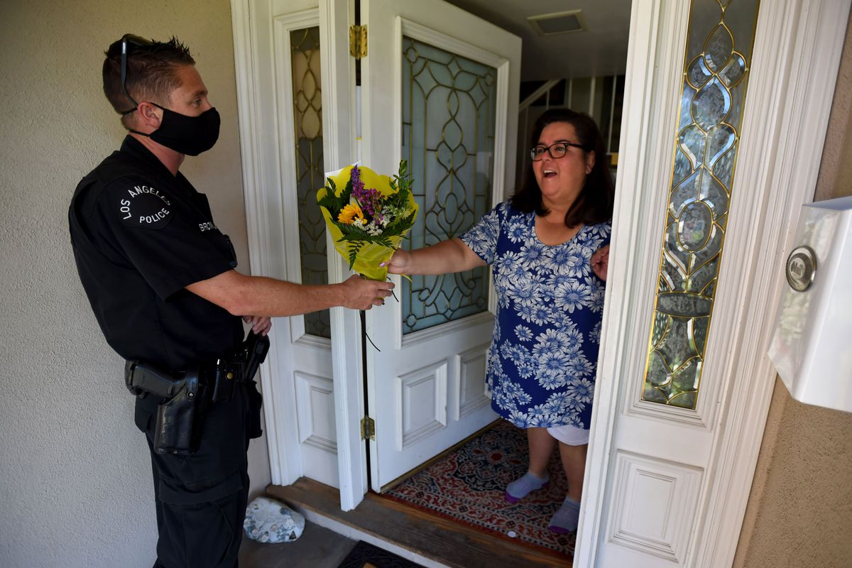 LAPD officers deliver flowers to deserving mothers.