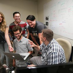 Members of the tech and marketing teams Madeleine Flynn, Yenn Lei, Nate Hardyman, Megan Morton and Jed Ashford, left to right, discuss the design for a new web feature at VidAngel's office in Provo on Wednesday, July 20, 2016.