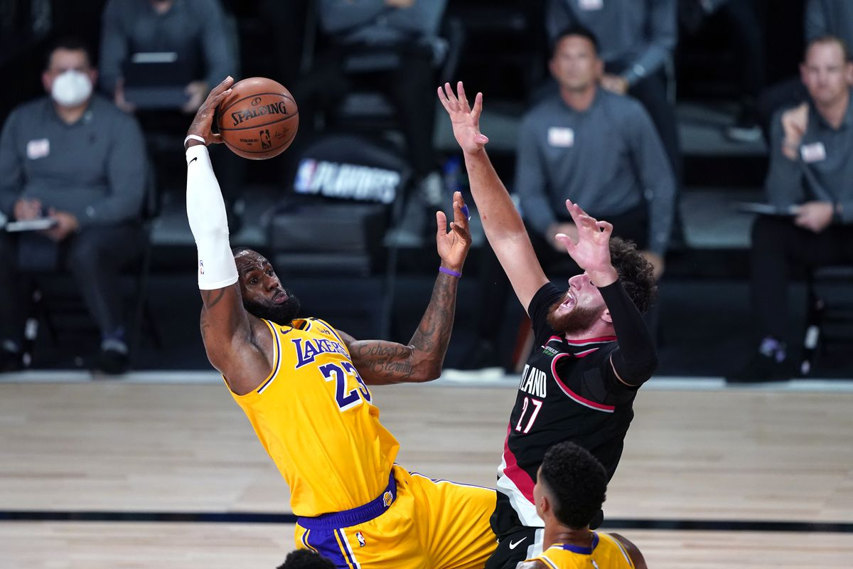 LeBron James of the Los Angeles Lakers battles against Jusuf Nurkic of the Portland Trail Blazers during the first half in Game 1 of Round 1 of the NBA Playoffs at AdventHealth Arena at ESPN Wide World Of Sports Complex on August 18, 2020 in Lake Buena Vista, Florida