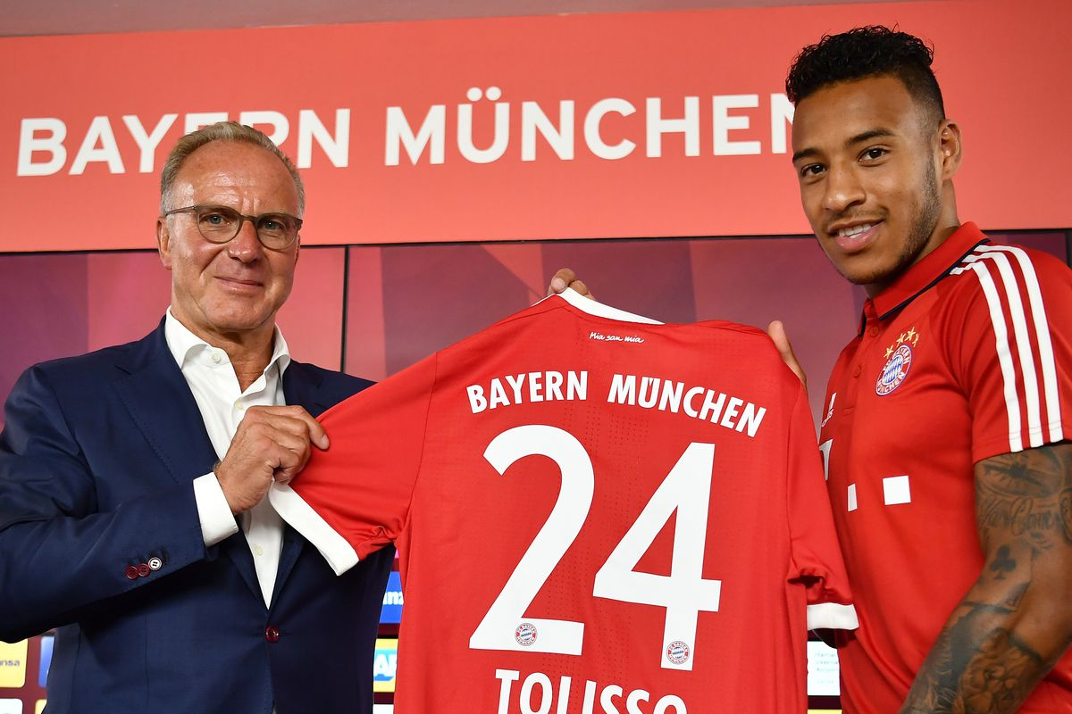 MUNICH, GERMANY - JULY 10: Karl-Heinz Rummenigge, CEO of FC Bayern Muenchen presents with Corentin Tolisso his new jersey number at Saebener Strasse training ground on July 10, 2017 in Munich, Germany.