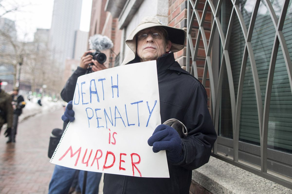 A man protests the death penalty.
