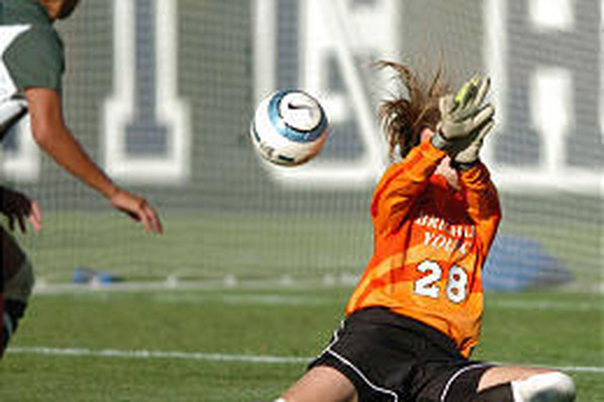 BYU keeper Erika Woodbury, here blocking a point-blank Hawaii shot, is one of the first-year Cougar players.