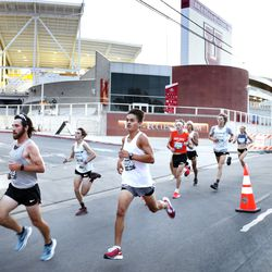 Runners compete in the Deseret News 10K in Salt Lake City on Friday, July 23, 2021.