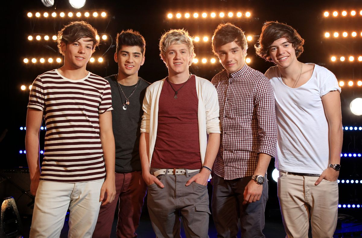 One Direction's Louis Tomlinson, Zayn Malik, Niall Horan, Liam Payne, and Harry Styles stand together at a photoshoot in 2012.