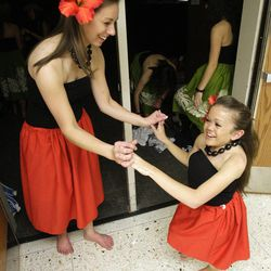 BYU student Kelsey Morasco and friend Ashley Mauger celebrate after their BYU Luau 2012 dance in Provo March 27, 2012.