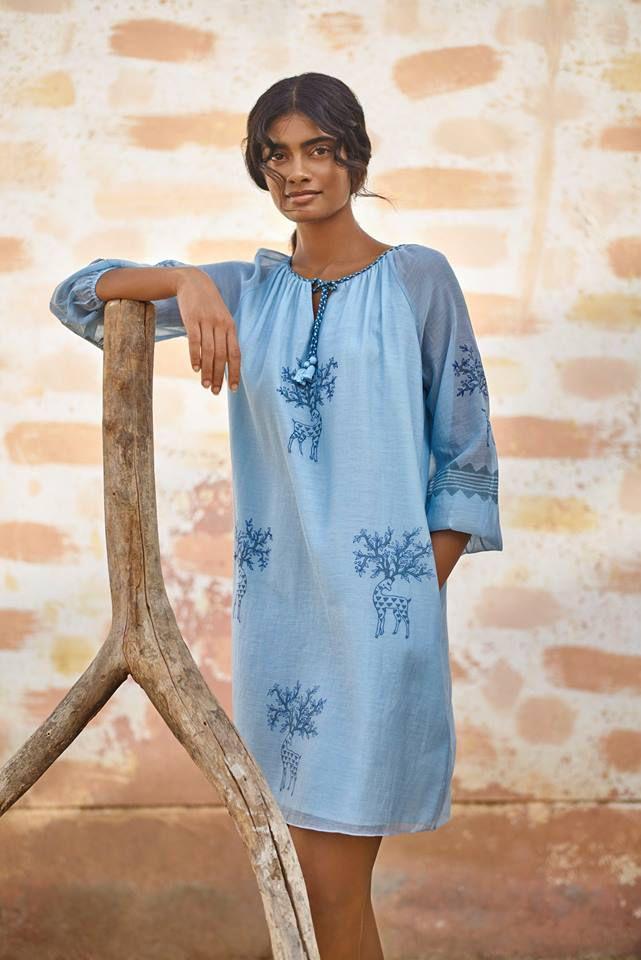 A model in a blue dress
