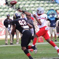 Ohio State's Kenny Guiton throws on the run.