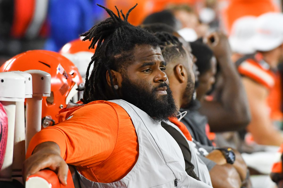Defensive tackle Sheldon Richardson of the Cleveland Browns watches the action from the sideline in the fourth quarter of a preseason game against the Detroit Lions on August 29, 2019 at FirstEnergy Stadium in Cleveland, Ohio.