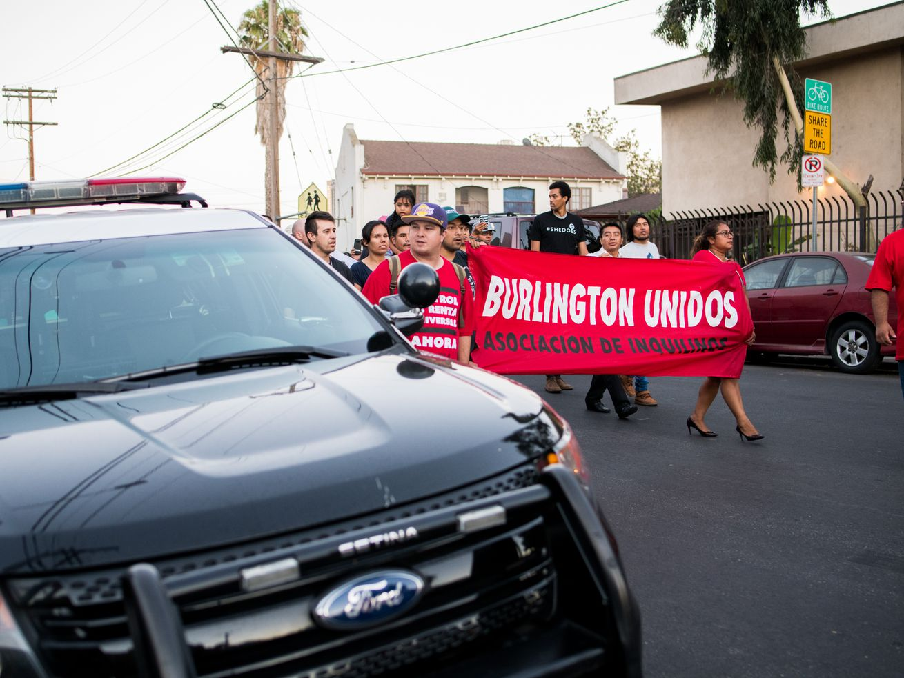 Members of Burlington Unidos protest in front of their Westlake apartments on July 20 as part of an ongoing rent strike.