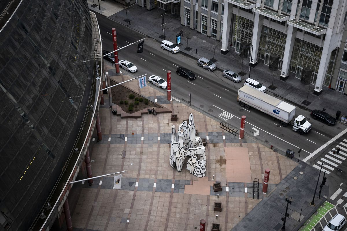 Amid fears of the coronavirus pandemic and a stay-at-home order from Gov. J.B. Pritzker, the Thompson Center plaza sits empty in the Loop, as seen while looking east on West Randolph Street from the roof of City Hall, during the Wednesday morning commute, April 1, 2020.   Ashlee Rezin Garcia/Sun-Times