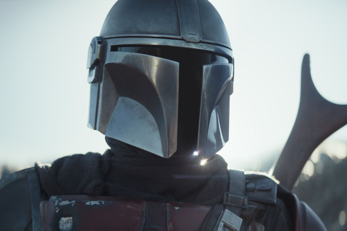 """A futuristic helmeted warrior from """"The Mandalorian"""" Star Wars series."""
