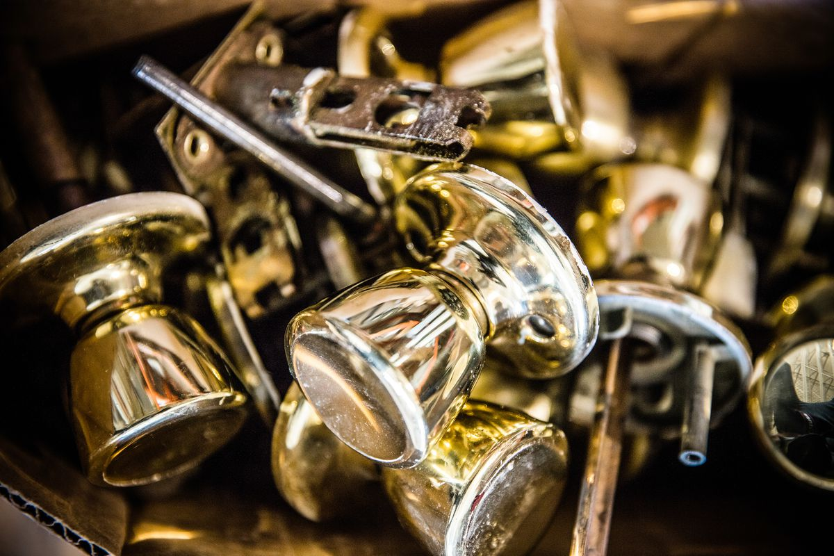 Various gold door knobs.