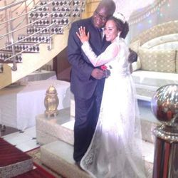 Bosco Kayembe and his wife, Amina Ait Omar, during their wedding.