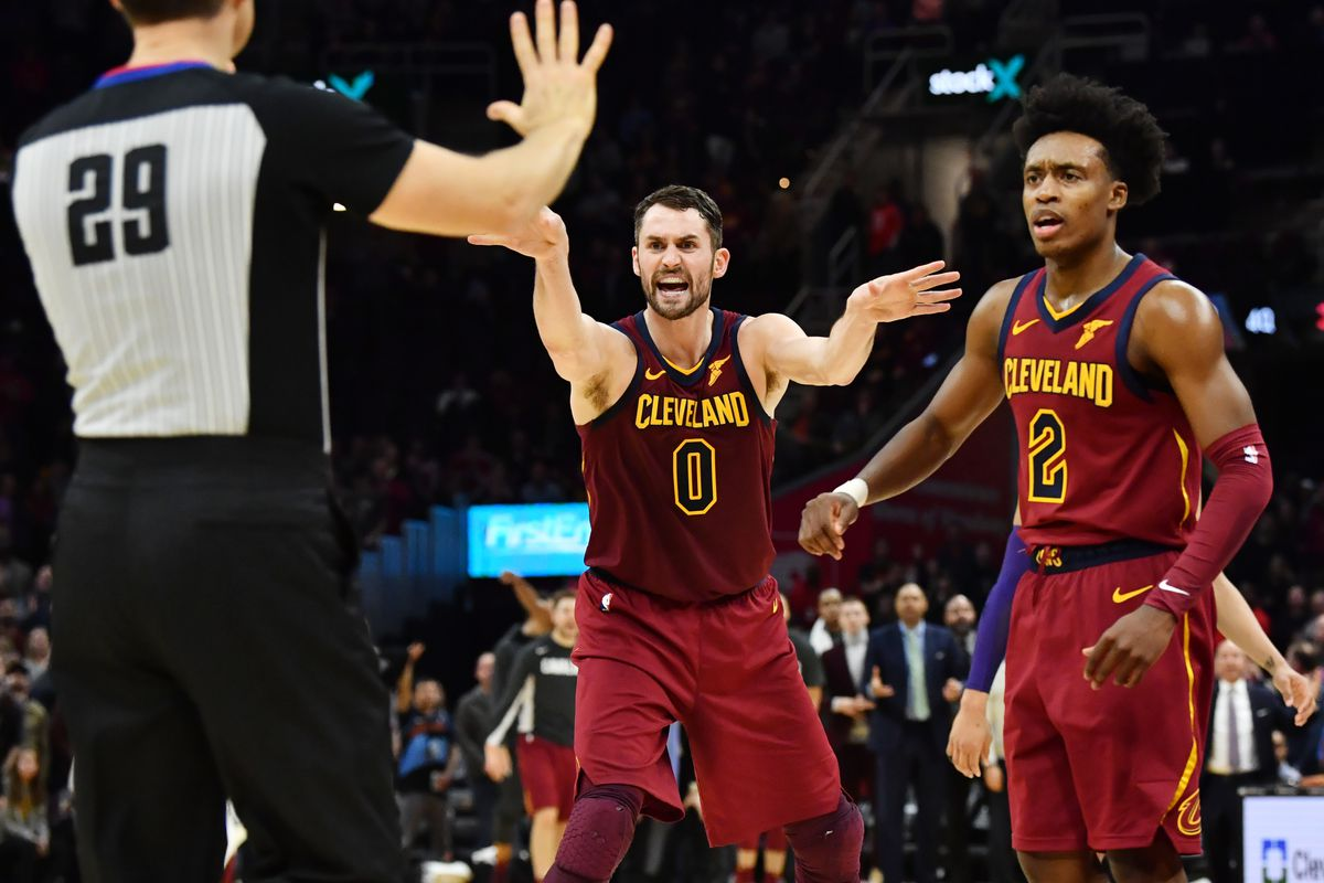 Cleveland Cavaliers forward Kevin Love and guard Collin Sexton argue a call with referee Mark Lindsay late in the fourth quarter against the Charlotte Hornets at Rocket Mortgage FieldHouse.