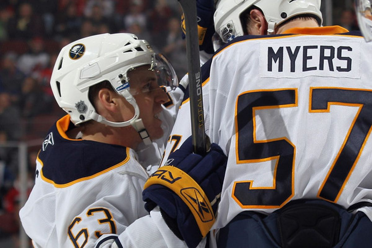 Ennis congratulating Myers on learning how to do a hockey stop.