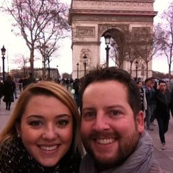 Tyler Barnett and Jenna Watson at the Arc de Triomphe in Paris, France after their engagement.