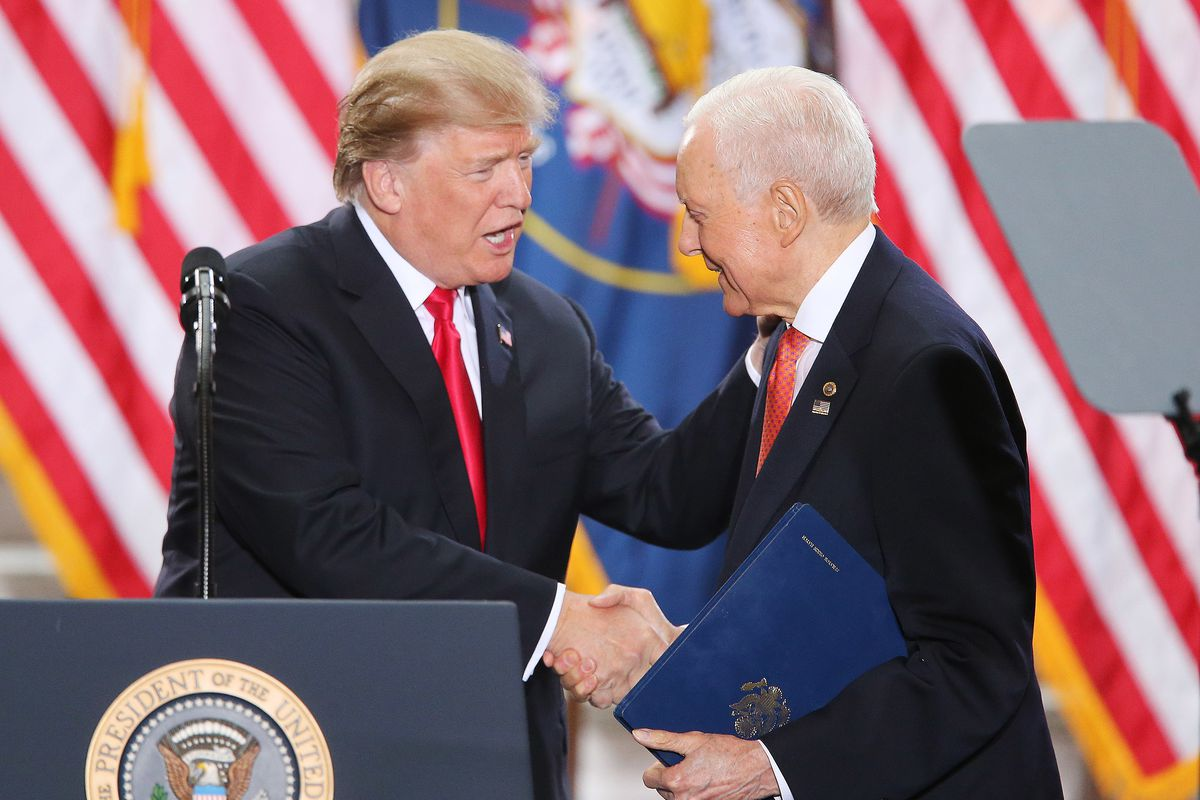 FILE - President Donald Trump shakes the hand of Sen. Orrin Hatch, R-Utah, after Hatch spoke at the Capitol rotunda in Salt Lake City on Dec 4, 2017. Trump was in Salt Lake City to announce reductions to the Grand Staircase-Escalante and Bears Ears nation