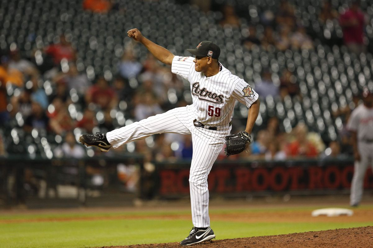 Aug 6, 2012; Houston, TX; USA; Houston Astros relief pitcher Wilton Lopez (59) pitches against the Washington Nationals in the tenth inning at Minute Maid Park. Mandatory Credit: Thomas Campbell-US PRESSWIRE