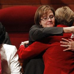 Sister Linda K. Burton hugs Sister Julie B. Beck after the 182nd Annual General Conference for The Church of Jesus Christ of Latter-day Saints at the LDS Conference Center in Salt Lake City on Saturday, March 31, 2012.