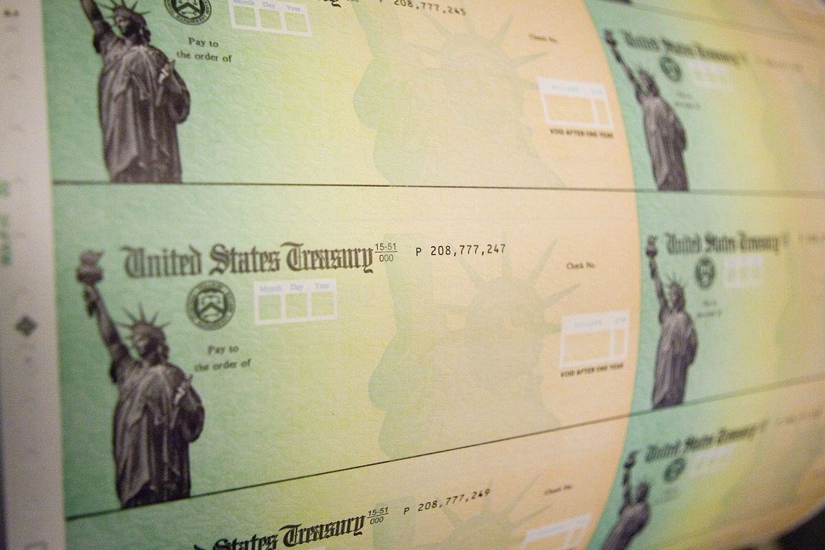 Blank checks from the United States Treasury featuring a picture of the Statue of Liberty.