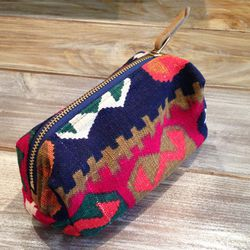<b>December Thieves</b> has a whole slew of sustainable stocking stuffers, but we especially adore this pouch from Fritz & Frauelin made with scrap textiles, $38.