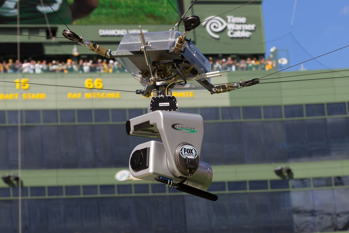 Sep 9, 2012; Green Bay, WI, USA;  A Fox tv camera hangs over the field during the game between the San Francisco 49ers and Green Bay Packers at Lambeau Field.  The 49ers defeated the Packers 30-22.  Mandatory Credit: Jeff Hanisch-US PRESSWIRE