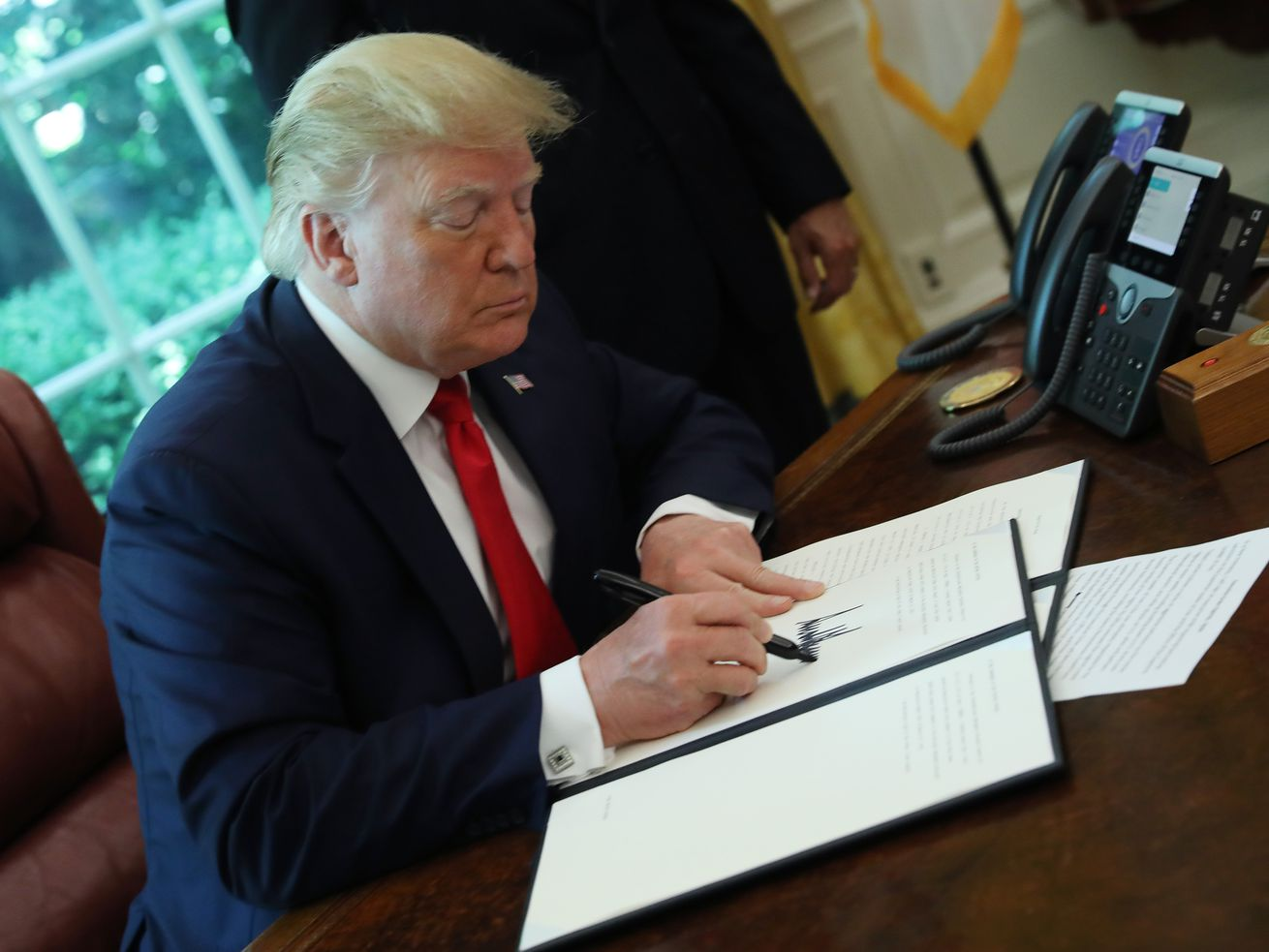 President Donald Trump signs an executive order imposing new sanctions on Iran on June 24, 2019, in Washington, DC.