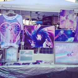 """Lisa Frank would approve of <a href=""""http://www.funkycatsterz.com/""""target=""""_blank"""">Funky Catsterz</a>'s booth."""