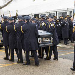 Pallbearers place Chicago Police Officer Samuel Jimenez's casket into the hearse. |  Ashlee Rezin/Sun-Times