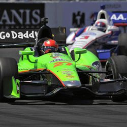 James Hinchcliffe, left, of Canada, races in front of Helio Castroneves, of Brazil, during the IndyCar Series' Toyota Grand Prix of Long Beach auto race, Sunday, April 15, 2012, in Long Beach, Calif. Hinchcliffe took third in the race.