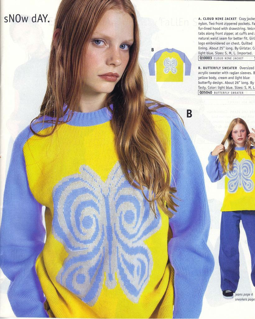 A catalog model wears a yellow and blue butterfly sweater.