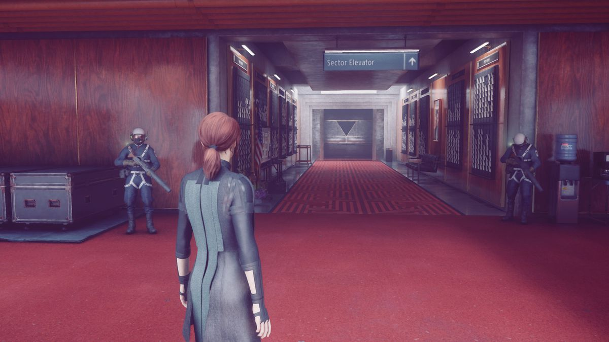 Control's protagonist, Jesse, stands down the hallway from the Sector Elevator